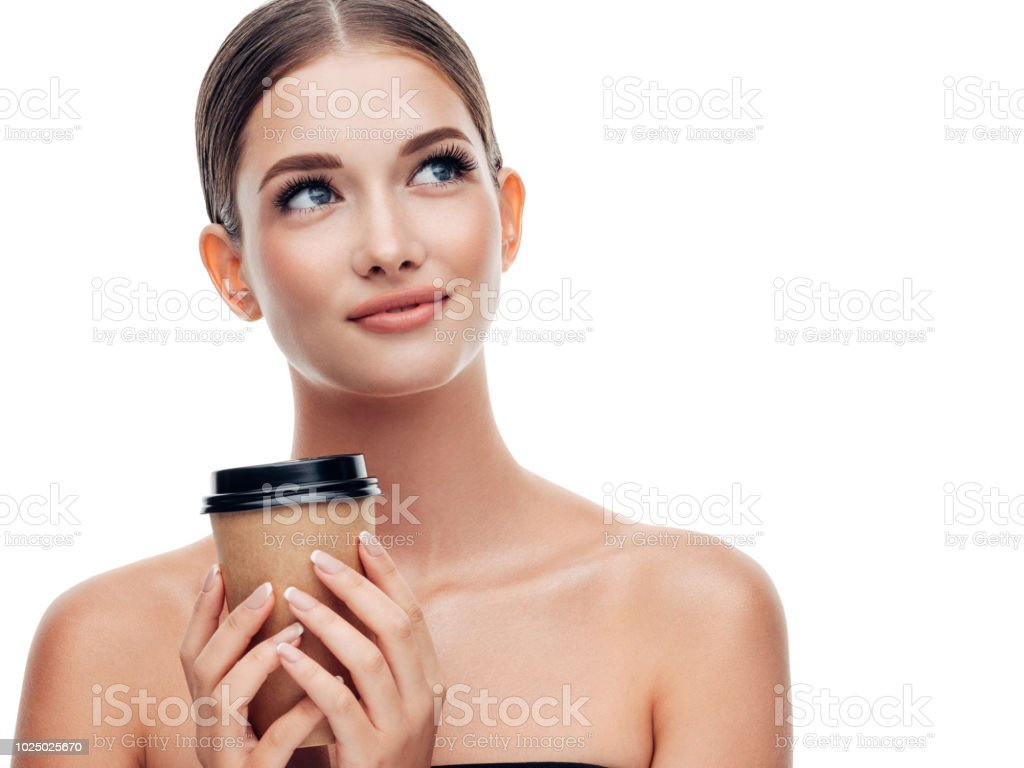 Woman holds cup of coffee stock photo