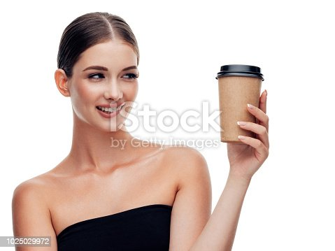 Woman holds cup of coffee