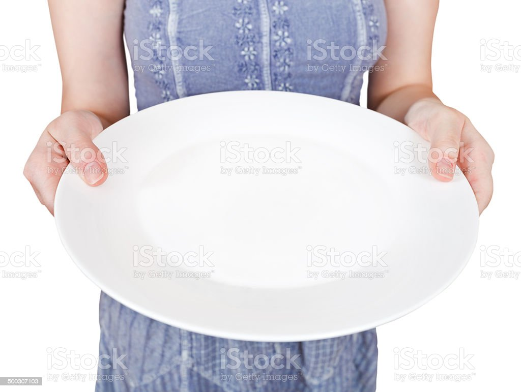 woman holds empty white plate stock photo