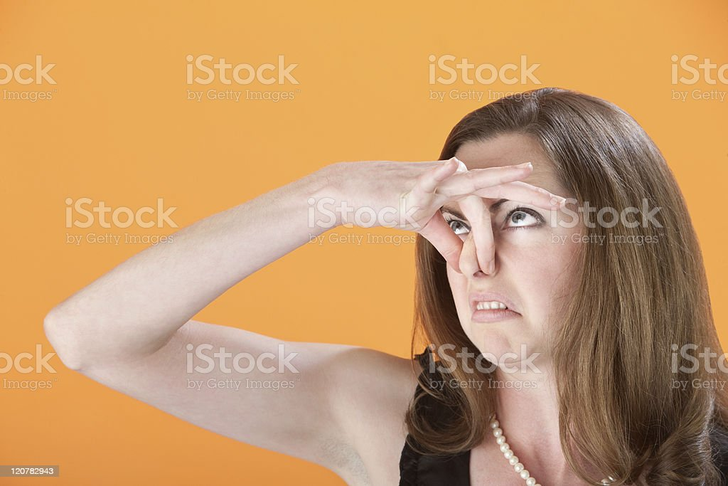 Woman Holds Her Nose stock photo