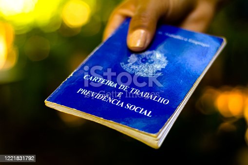 Woman holds his Brazilian document work and social security (Carteira de Trabalho e Previdencia Social).