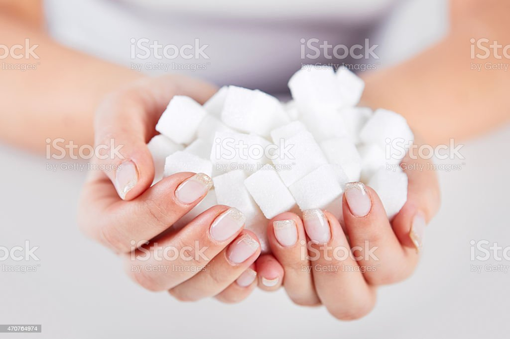 Woman holds in hands of sugar cubes royalty-free stock photo