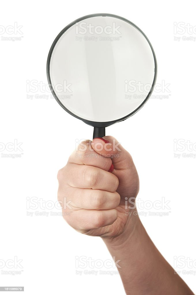 woman holds magnifying glass royalty-free stock photo