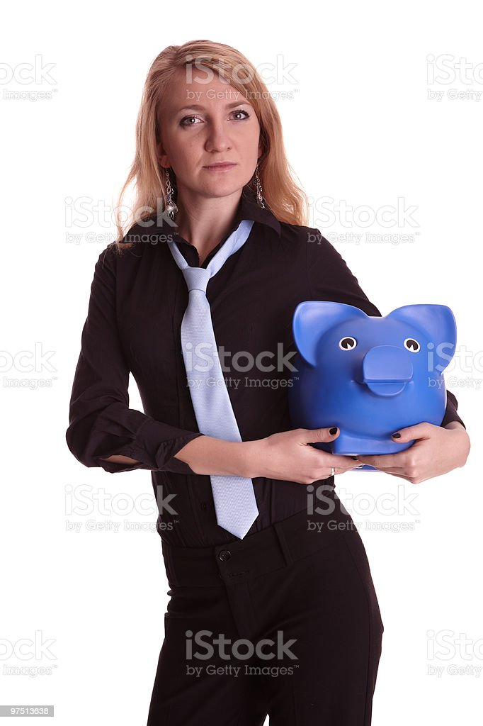 Woman holds piggy bank royalty-free stock photo