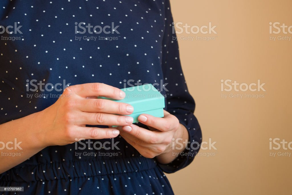 Woman holds small blue gift boxes. Present. gift. stock photo