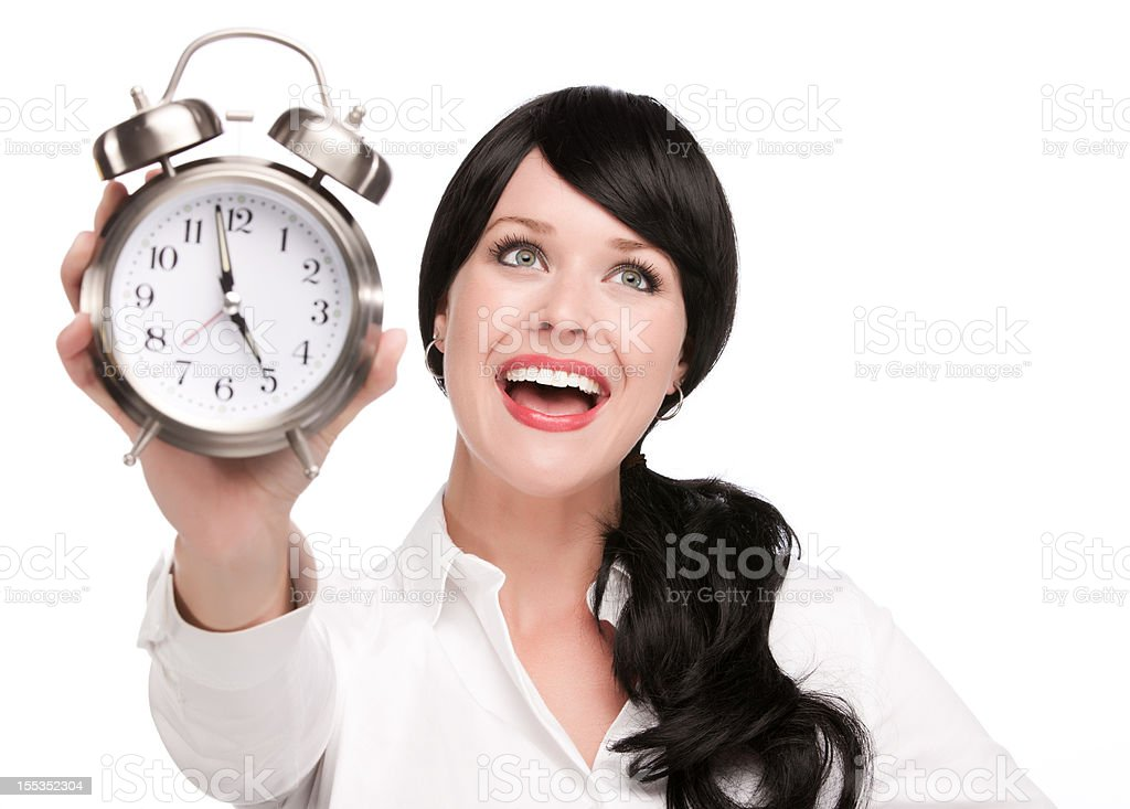Woman Holds Up Clock To Show the Time royalty-free stock photo