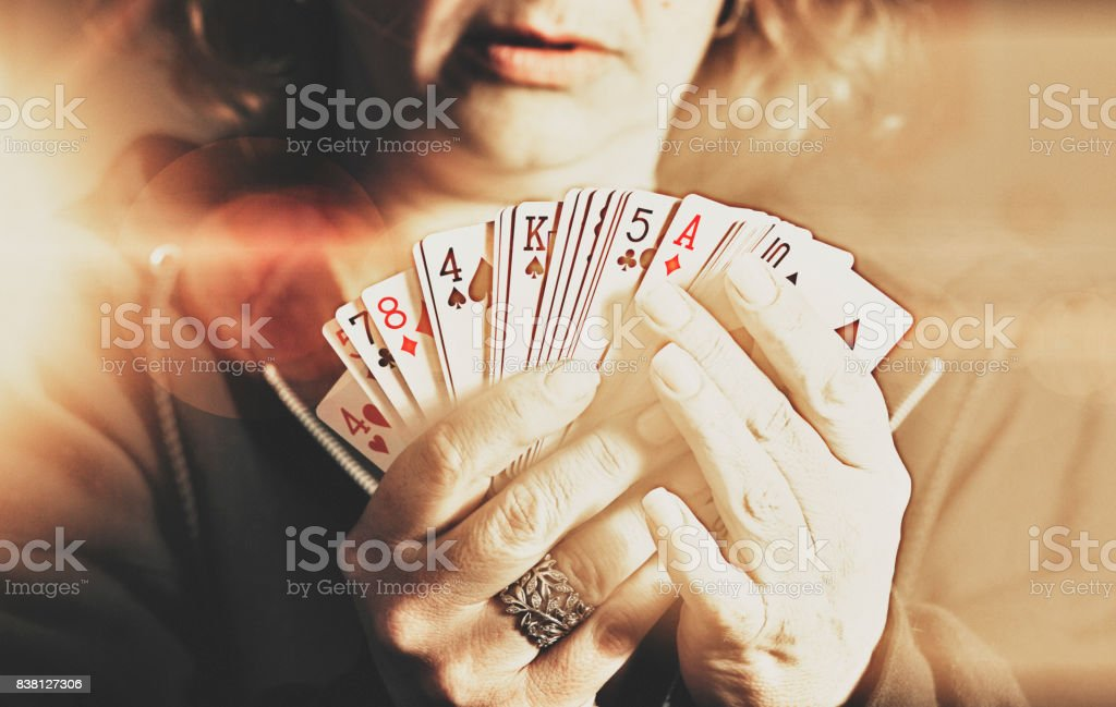 Woman holds up her cards while gambling in a casino stock photo