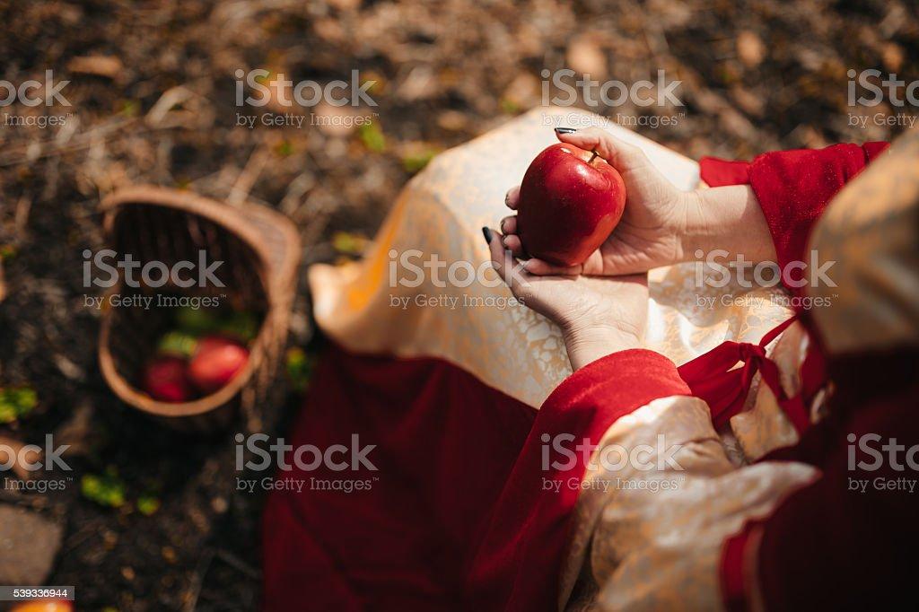 Woman holging an apple stock photo