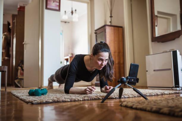 Woman home exercising stock photo