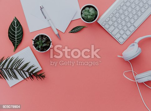 istock Woman home office desk workspace with laptop, headphones and plants over pastel. Flat lay, top view. stylish female concept. 925079904