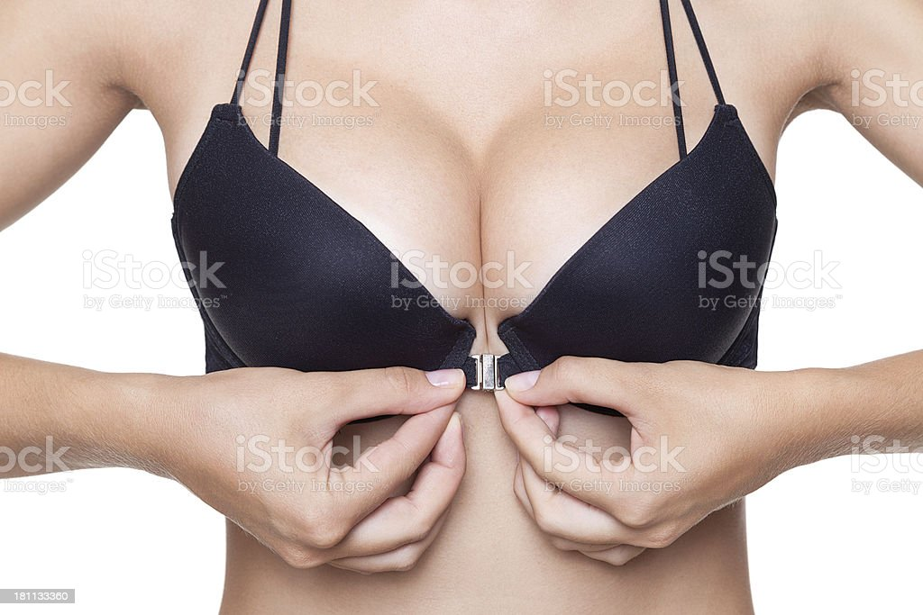 Woman hooking black bra with front clasp stock photo