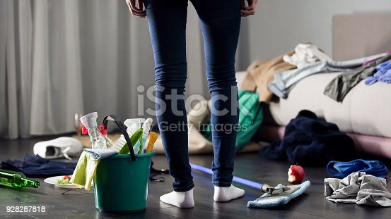 Woman horrified by mess left after party in her apartment, cleaning service, stock footage