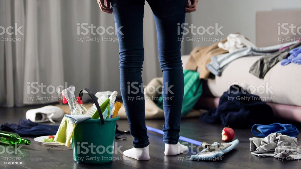 Woman horrified by mess left after party in her apartment, cleaning service stock photo