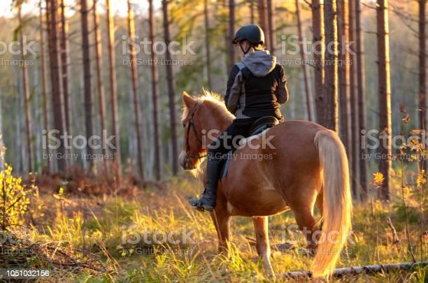 Woman horseback riding in forest picture id1051032156?b=1&k=6&m=1051032156&s=612x612&h=eq1nmbr 6l2x8x6gsnxqjijpgjwzqolgwbh kt9qko8=