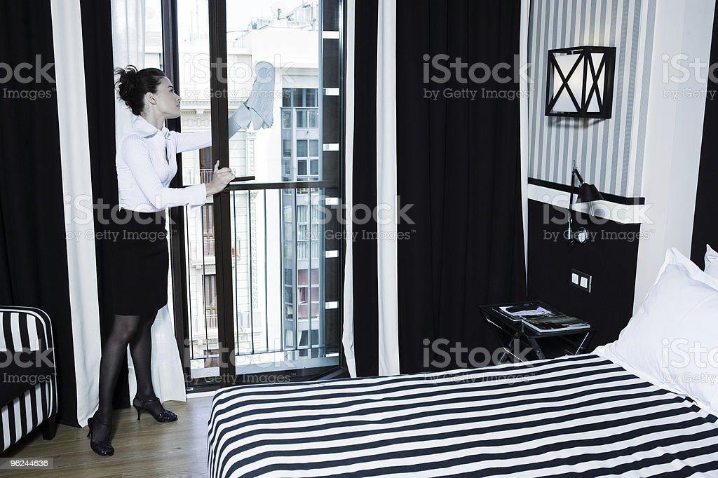 woman hotel room housekeeping cleaning