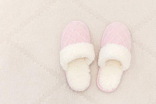 Woman house slipper on floor carpet slippers stock photo
