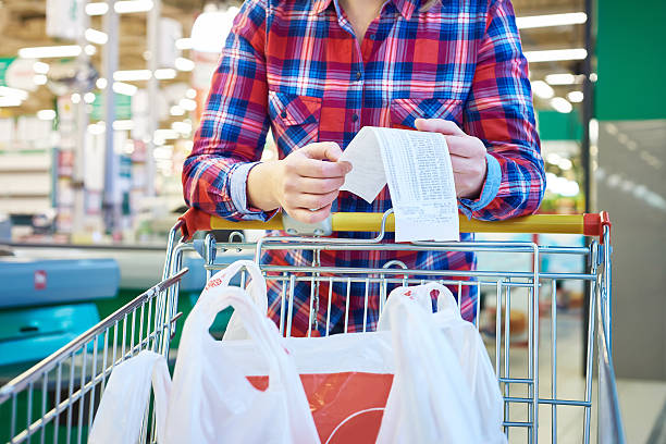 Woman housewife looking check in store stock photo