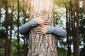 istock Woman hug the tree 1188406535