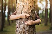 istock Woman hug the tree 1188406564