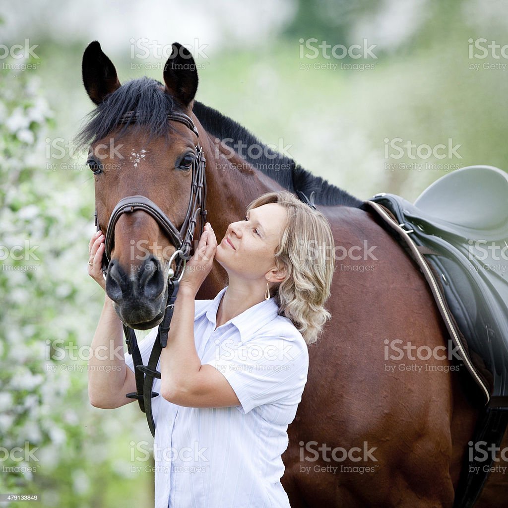 Woman hugging a horse royalty-free stock photo