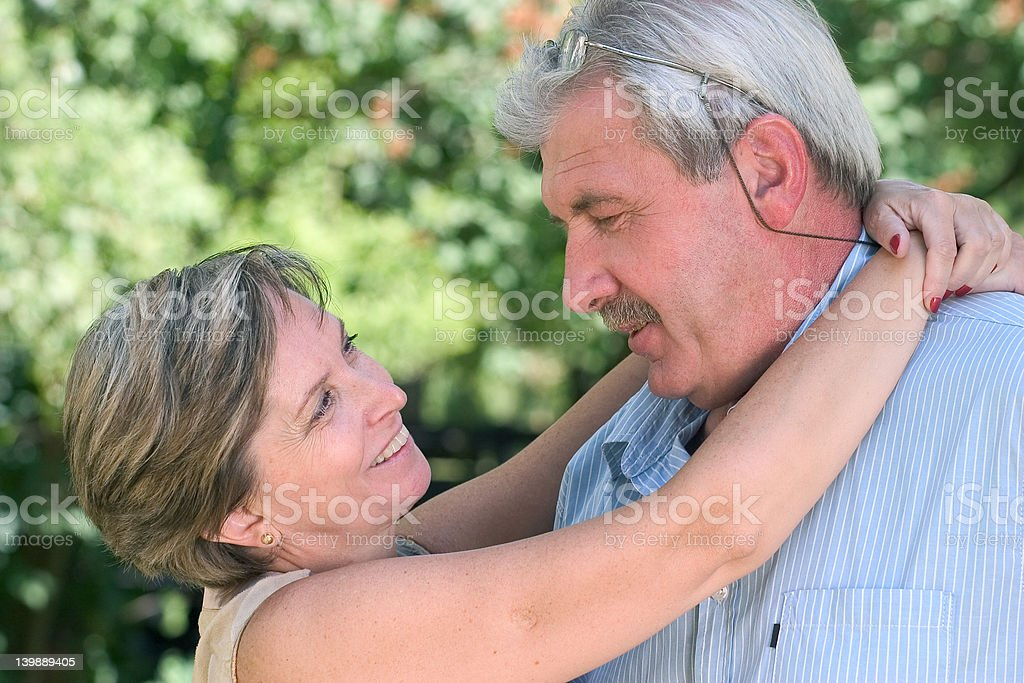 Woman hugging a man royalty-free stock photo