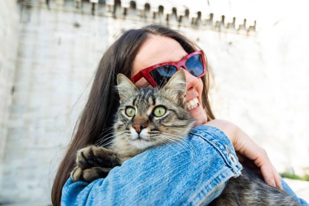 Woman hugging cat in Istanbul stock photo