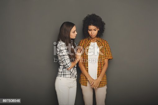 istock Woman hugging her depressed friend 897508546