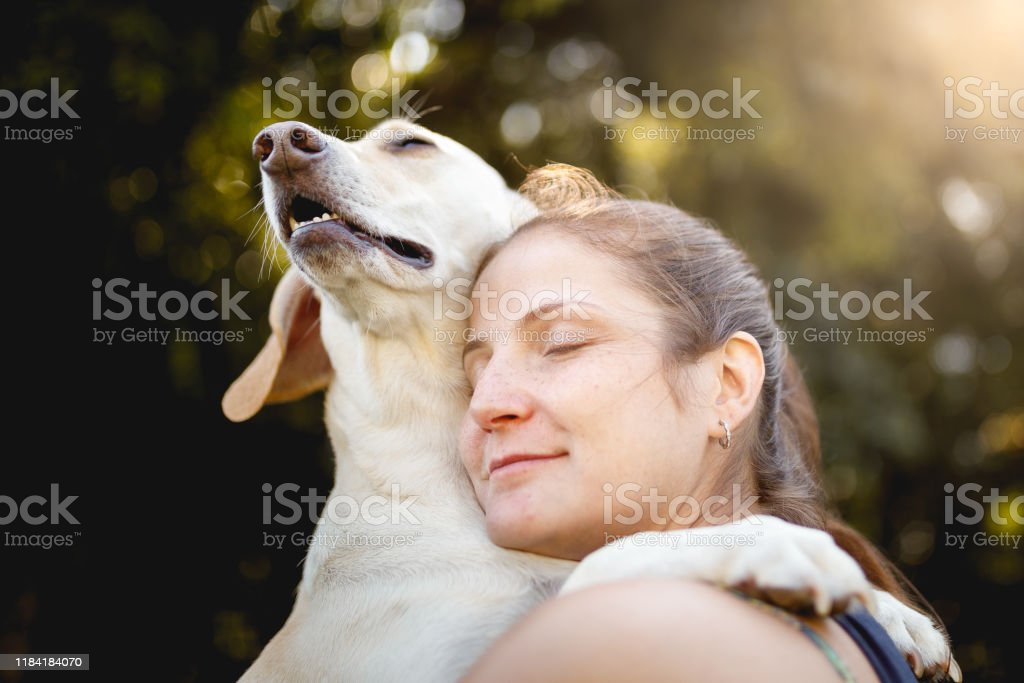 Woman hugging her dog - Royalty-free Adult Stock Photo