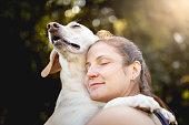 Woman hugging her dog.