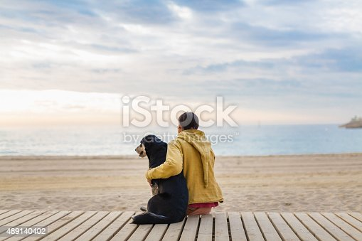 woman with her dog admire the horizon sea