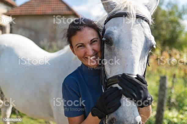 Woman hugging horse picture id1063665930?b=1&k=6&m=1063665930&s=612x612&h=f5osg35zic fpqf4ke4q9j8d8sjiuw3opj5jng2sbrg=
