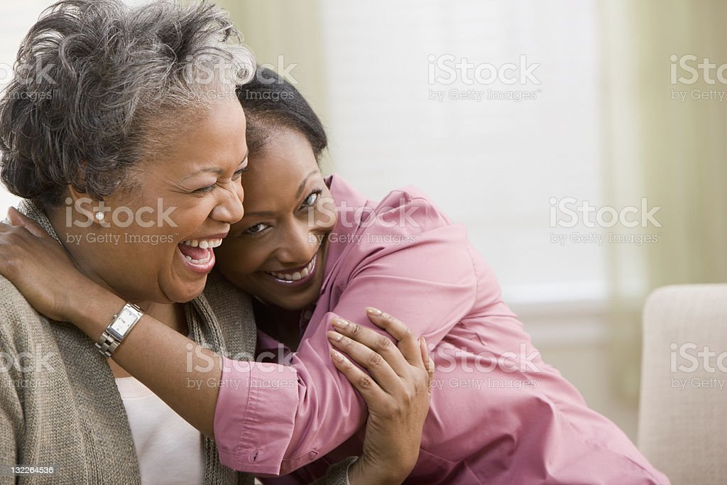 Woman hugging mother stock photo