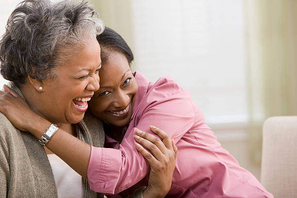 woman hugging mother - daughter stock photos and pictures