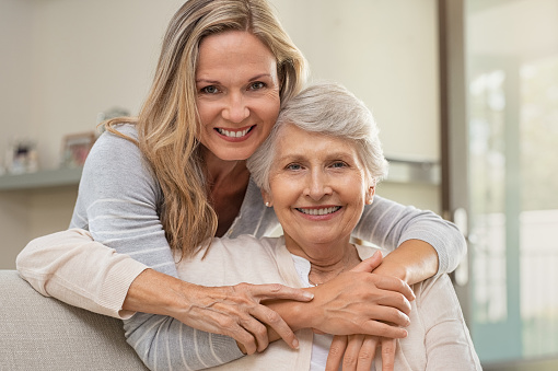 istock Woman hugging mother with love 1029343480
