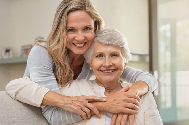 woman hugging mother with love - daughter stock photos and pictures