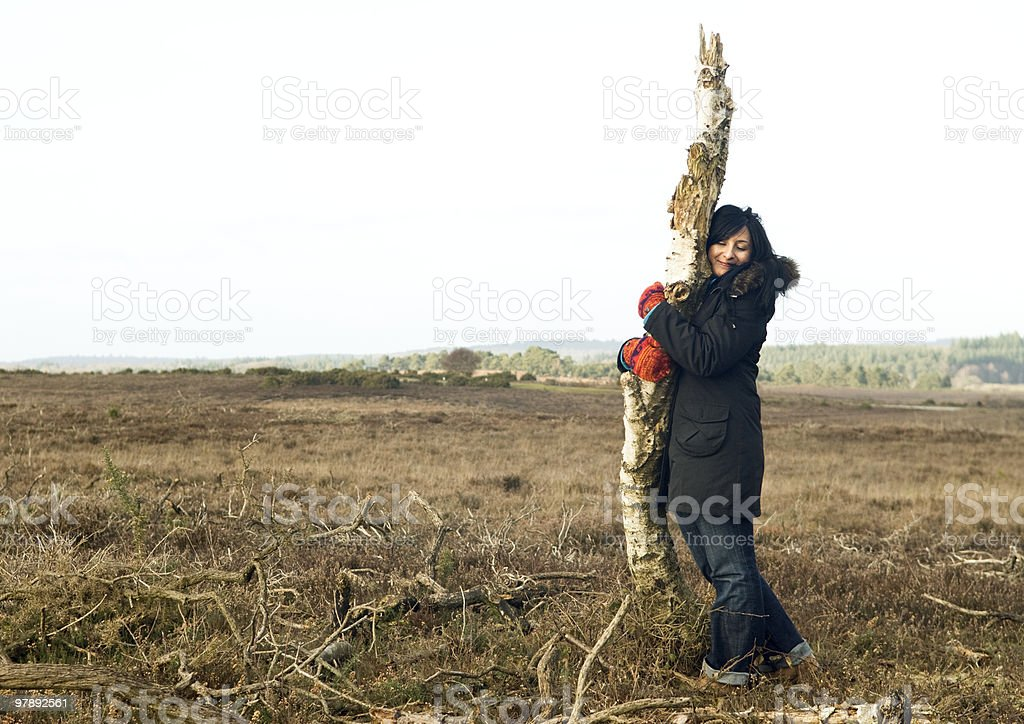 woman hugging the last tree royalty-free stock photo
