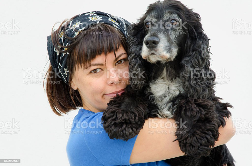Woman hugs her lovely dog stock photo