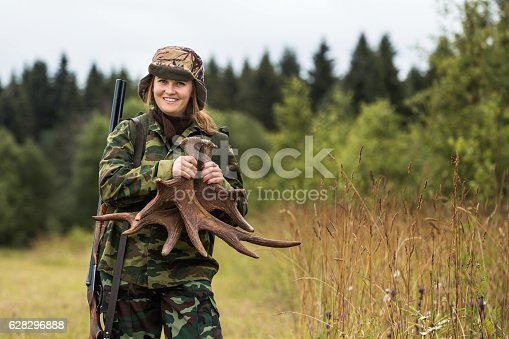 istock Woman hunter in the forest. 628296888