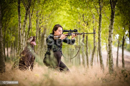 istock Woman hunter in the woods 1073989068