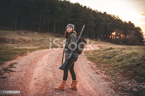 Woman hunter, looking for birds