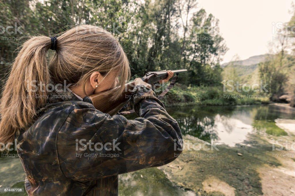 Woman hunting stock photo