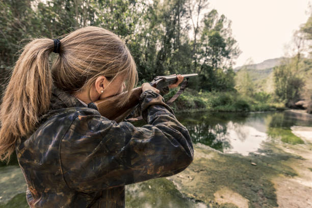 Woman hunting Woman bird hunter hunter stock pictures, royalty-free photos & images