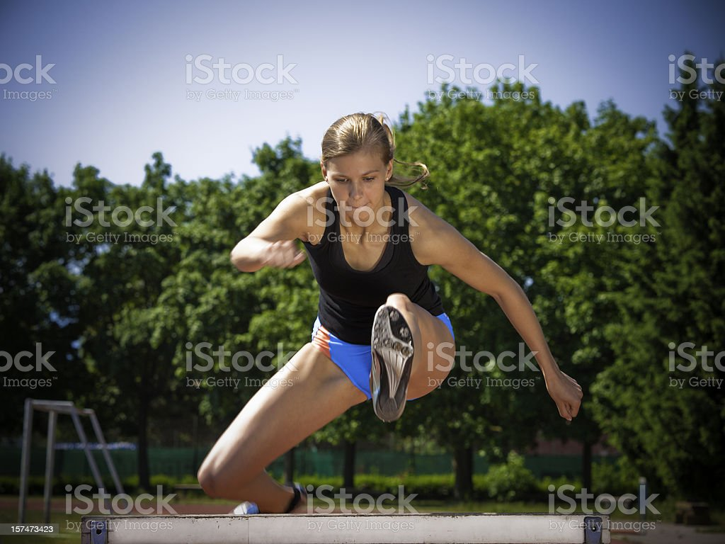 Woman Hurdling royalty-free stock photo