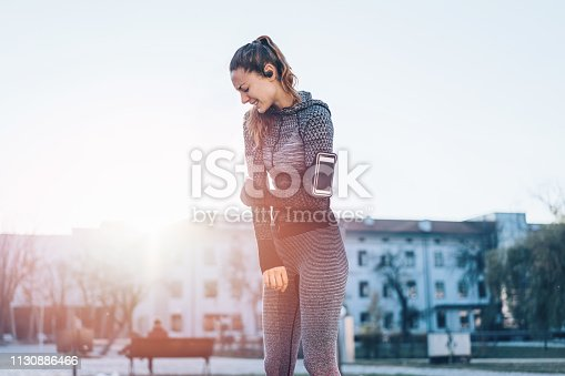 Young athletic woman feeling sharp pain and discomfort due to arm stiffness