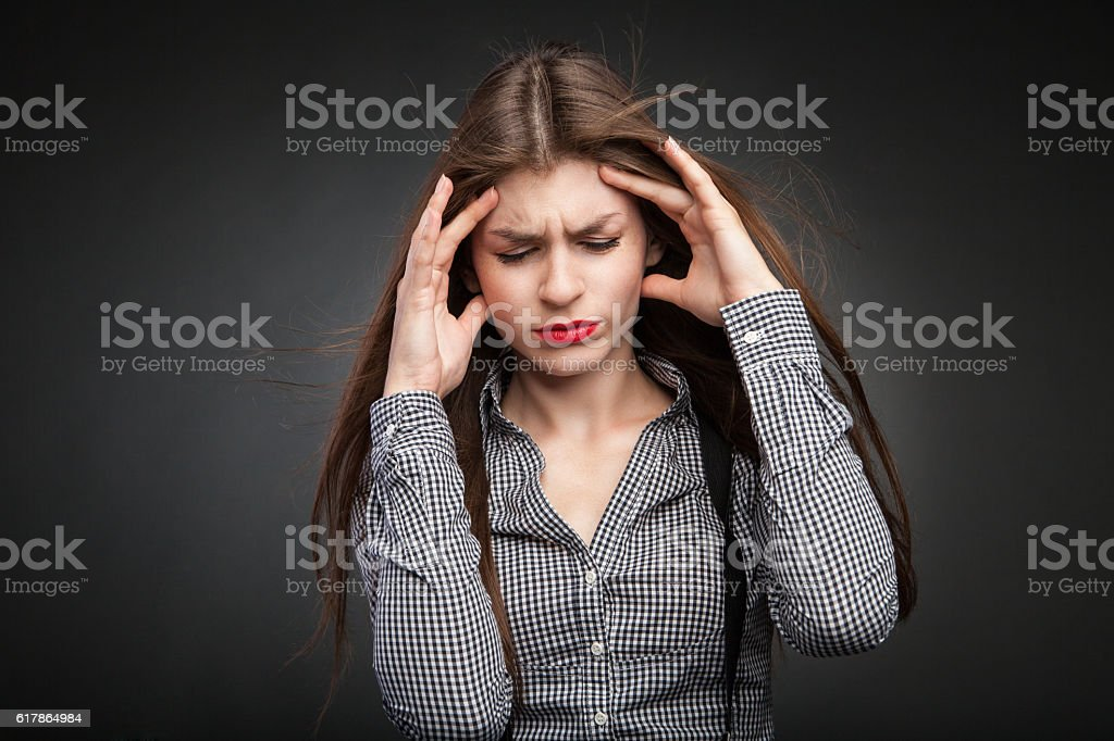 Woman hurts with headache. stock photo