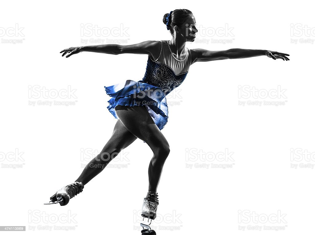 A woman ice skater skating in a beautiful dress stock photo