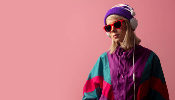 woman in 90s clothes with sunglasses and headphones stock photo