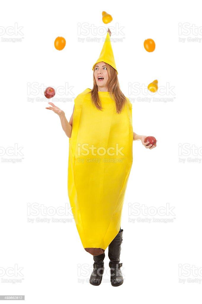 Frau In Einem Banana Kostum Jonglieren Obst Stock Fotografie Und