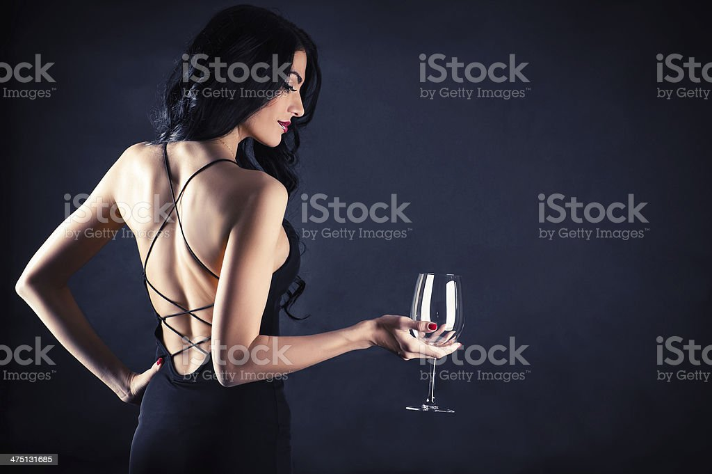 woman in a black dress stock photo