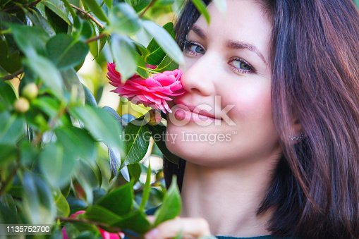 Woman in a blooming garden.